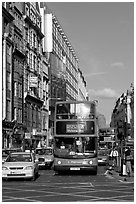 Double decker busses in a busy street. London, England, United Kingdom (black and white)