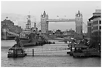Historic boats, quays along the Thames, and Tower Bridge, late afternoon. London, England, United Kingdom (black and white)