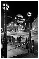 Underground  entrance and lights from traffic at night, Piccadilly Circus. London, England, United Kingdom ( black and white)