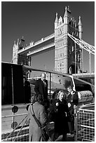 Passengers disembarking a boat in their morning commute, Tower Bridge in the background. London, England, United Kingdom ( black and white)