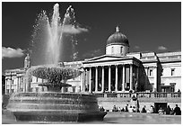 Fountain and National Gallery, Trafalgar Square, mid-day. London, England, United Kingdom (black and white)