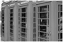 Row of Red phone booths. London, England, United Kingdom (black and white)