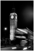 Double-decker bus in motion and Big Ben at night. London, England, United Kingdom (black and white)
