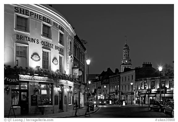 Tavern, street, and church at night. Greenwich, London, England, United Kingdom (black and white)