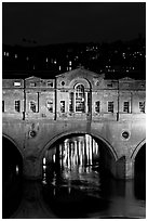 Central section of Pulteney Bridge, covered by shops,  at night. Bath, Somerset, England, United Kingdom ( black and white)
