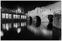 Pulteney Bridge, and quay reflected in River Avon at night. Bath, Somerset, England, United Kingdom ( black and white)