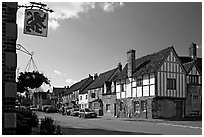 One of the four main streets  of National Trust village of Lacock. Wiltshire, England, United Kingdom (black and white)