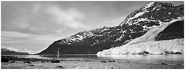 Landscape with tidewater glacier and waterfall. Prince William Sound, Alaska, USA (Panoramic black and white)