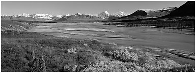 Tundra autumn scenery with wide river and mountains. Alaska, USA (Panoramic black and white)