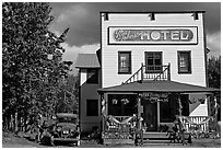 Small hotel with classic car parked by, afternoon. McCarthy, Alaska, USA ( black and white)