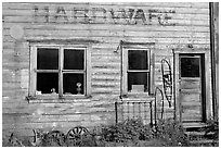 Windows and doors of old hardware store. McCarthy, Alaska, USA ( black and white)
