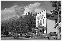 Hotel, main street, vintage car, and truck. McCarthy, Alaska, USA ( black and white)