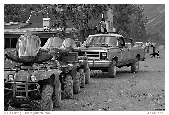 Four wheelers parked on main street. McCarthy, Alaska, USA (black and white)
