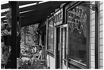 Man sitting in front of McCarthy lodge. McCarthy, Alaska, USA ( black and white)