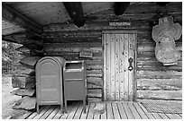 Mail boxes, log house post office, Slana. Alaska, USA (black and white)