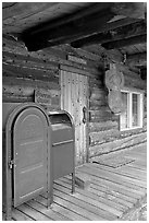 postal boxes, log house postal office, Slana. Alaska, USA (black and white)