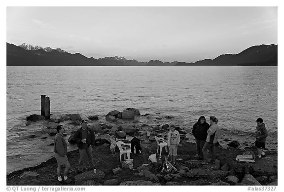 Families pickniking with fire, Resurrection Bay, sunset. Seward, Alaska, USA (black and white)
