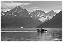 Fishing boat, mountains and glaciers. Seward, Alaska, USA ( black and white)