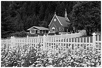 Flowers, white picket fence and church. Seward, Alaska, USA ( black and white)