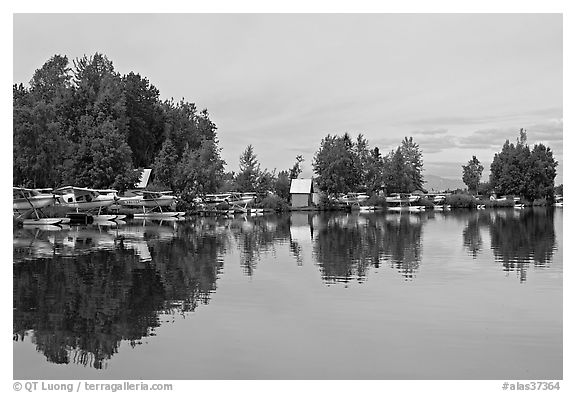 Sea planes and reflections. Anchorage, Alaska, USA (black and white)