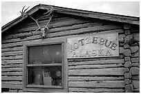 Log cabin with caribou antlers. Kotzebue, North Western Alaska, USA ( black and white)