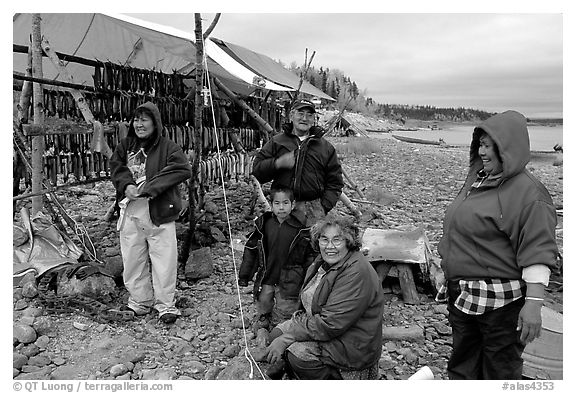 Inupiaq Eskimo family with stand of drying fish, Ambler. North Western Alaska, USA