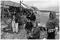 Inupiaq Eskimo family with stand of drying fish, Ambler. North Western Alaska, USA ( black and white)