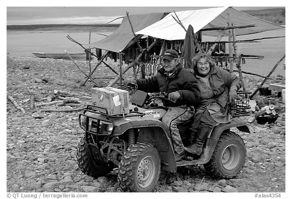 Inupiaq Eskimo man and woman riding on a four-wheeler, Ambler. North Western Alaska, USA (black and white)