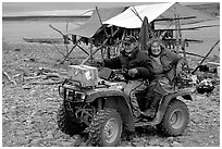 Inupiaq Eskimo man and woman riding on a four-wheeler, Ambler. North Western Alaska, USA ( black and white)