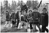 Inupiaq Eskimo kids and teacher, Kiana. North Western Alaska, USA ( black and white)