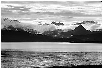 Low clouds haning over Kenai Mountains across Katchemak Bay. Homer, Alaska, USA (black and white)