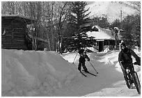 Winter recreation with snow-tired bike and skis. Wiseman, Alaska, USA (black and white)