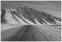 Frozen James Dalton Highway below Arctic Mountains. Alaska, USA ( black and white)