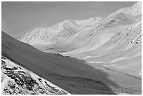 Snowy Arctic valley seen from Atigun Pass. Alaska, USA ( black and white)