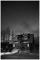 Cabin at night with Northern Lights. Wiseman, Alaska, USA ( black and white)