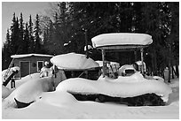 Machinery covered in snow. Wiseman, Alaska, USA ( black and white)