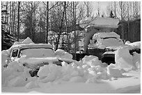 Trucks covered with piles of snow. Wiseman, Alaska, USA ( black and white)