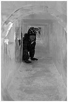 Girl inside ice tunnel, Ice Alaska. Fairbanks, Alaska, USA (black and white)
