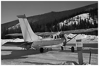Plane on frozen runway in winter. Chena Hot Springs, Alaska, USA (black and white)