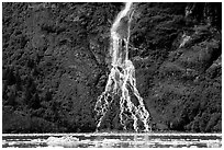 Waterfall dropping into the sea. Prince William Sound, Alaska, USA ( black and white)