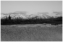 Lake with water ripples and mountains at sunset. Alaska, USA (black and white)