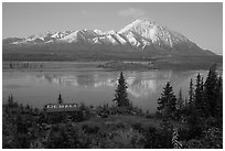 Mountains and lake at dusk, cabin with Denali sign. Alaska, USA ( black and white)