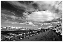Denali Highway under large white clouds. Alaska, USA ( black and white)