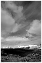 Mountain landscape with large white clouds. Alaska, USA ( black and white)