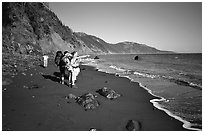 Backpackers on the beach,  Lost Coast. California, USA ( black and white)