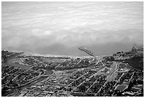 Aerial view of Santa Cruz with fog-covered ocean. Santa Cruz, California, USA ( black and white)