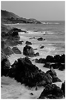 Coastline with pointed rocks and surf, sunset, Garapata State Park. Big Sur, California, USA ( black and white)