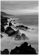 Rocks and surf near Rocky Cny Bridge, Garapata State Park, dusk. Big Sur, California, USA ( black and white)