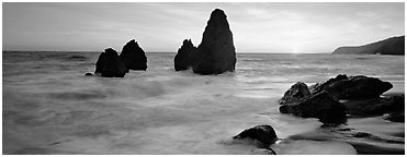 Sea stacks and setting sun, Rodeo Beach. California, USA (Panoramic black and white)