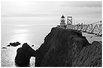 Narrow bridge leading to the Point Bonita Lighthouse, afternoon. California, USA ( black and white)